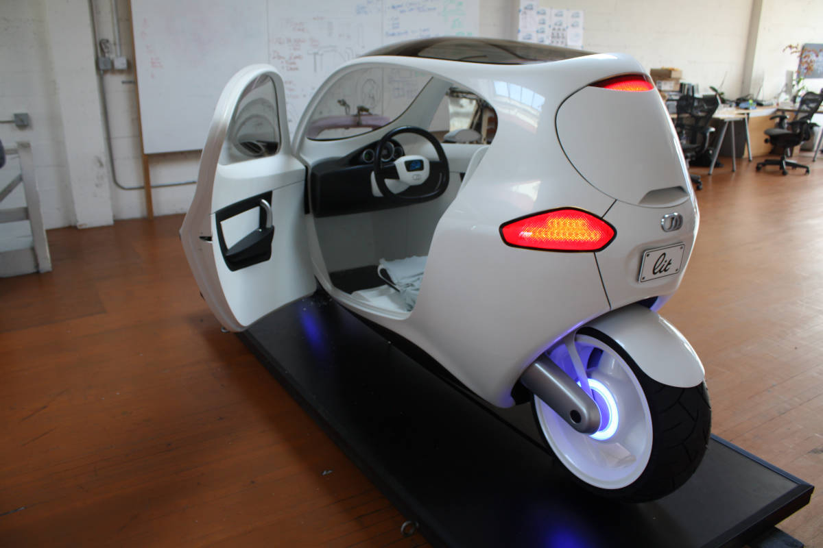 electric motorcycle enclosed - photo #17